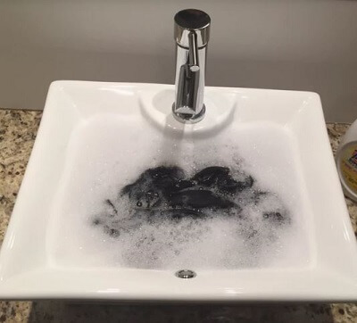 Wash Aulora Pants in sink